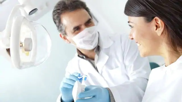 dentist talking with patient about dental sedation