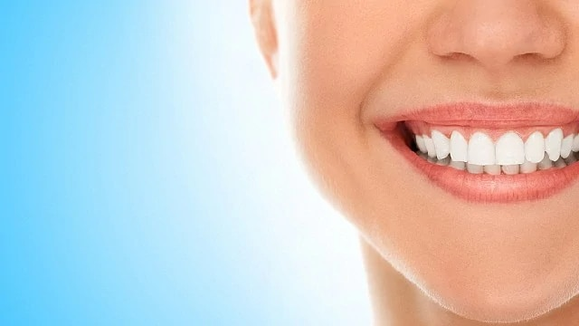 woman smiling after composite resin bonding treatment