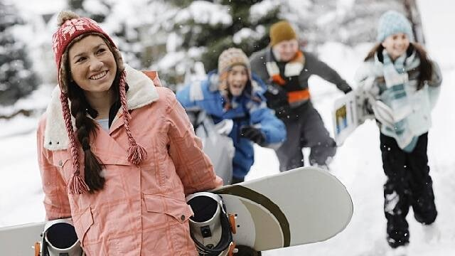 woman snowboarding after dental procedure
