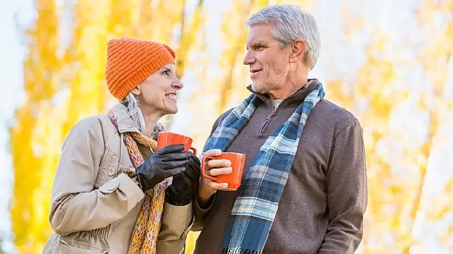 older couple drinking coffee together