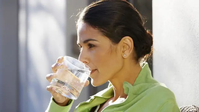 woman drinking water with fluoride