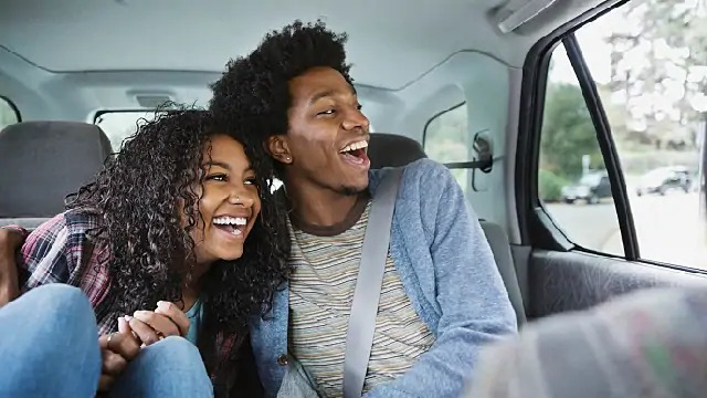 couple smiling together in car