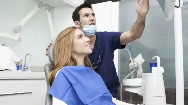 woman getting tooth decay treatment
