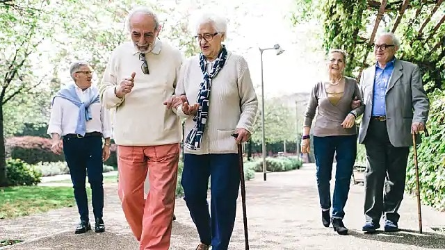 older couple with flexible dentures walking