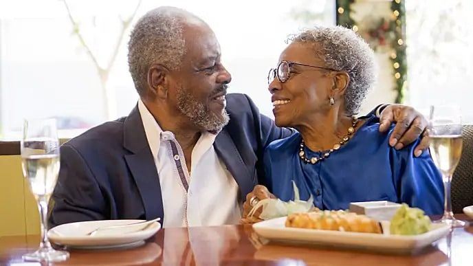 older couple smiling at each other