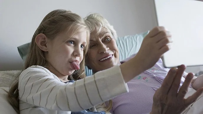 grandmother taking a picture with granddaughter
