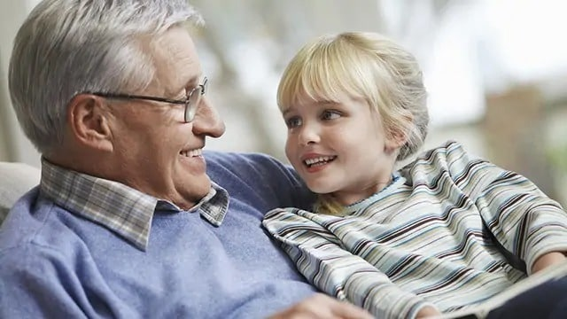 Young child smiling at a grandparent