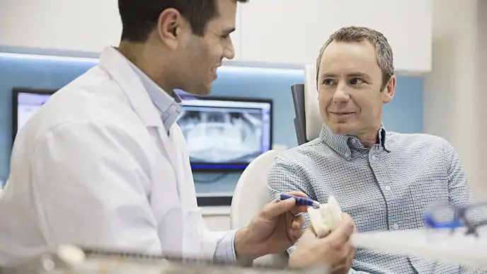 dentist showing patient new technology