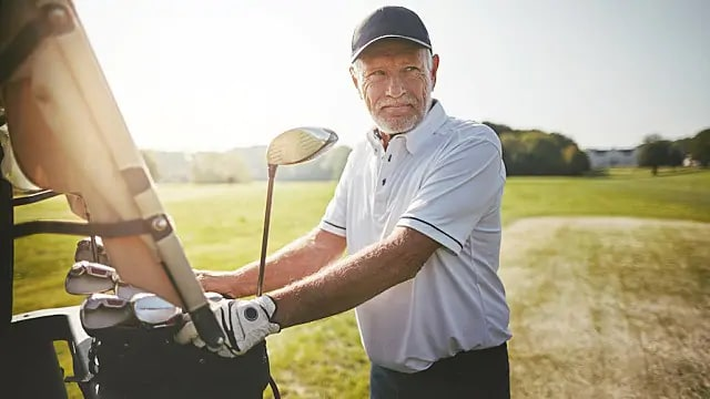 man golfing after root canal infection treatment