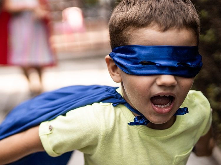 child dressed up as super hero