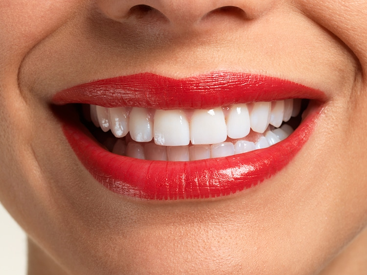 close up of smiling woman with white teeth