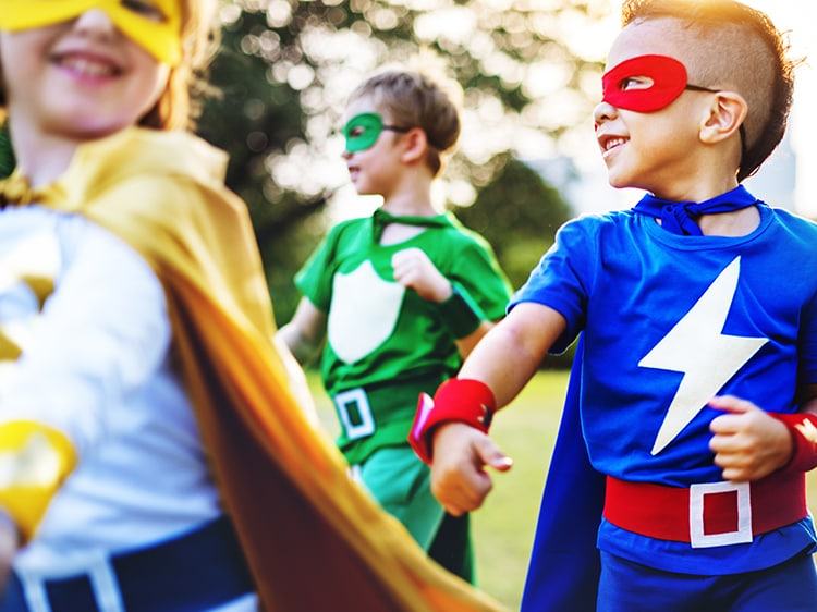 group of children dressed up as super heroes