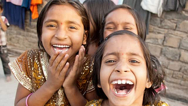 Indian kids laugh with their white teeth
