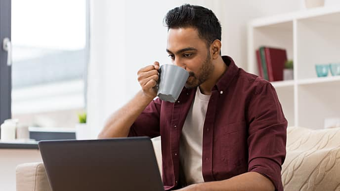 man having coffee and reading about mouth cancer