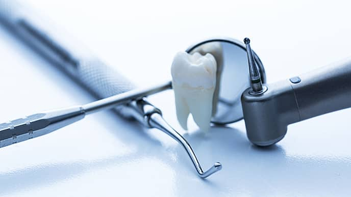 tooth next to dental equipment
