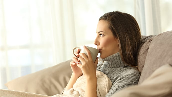 woman relaxing and drinking coffee
