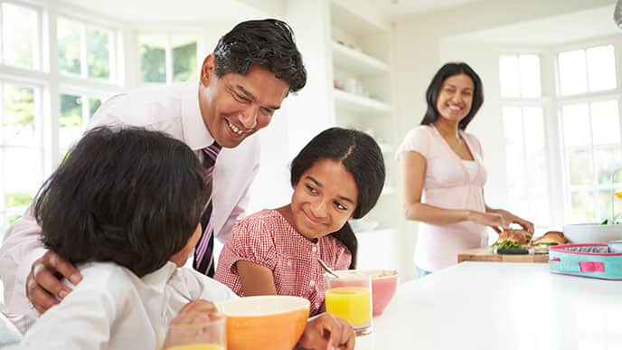 Dad teaching his children with eating habits good for teeth
