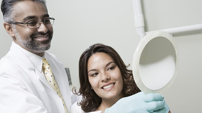 Dentist with patient who has tooth pain