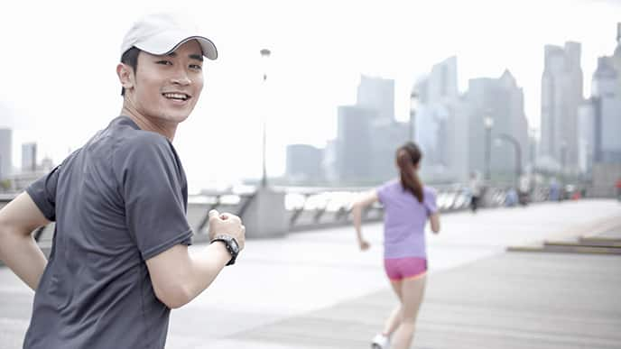 Asian couple running