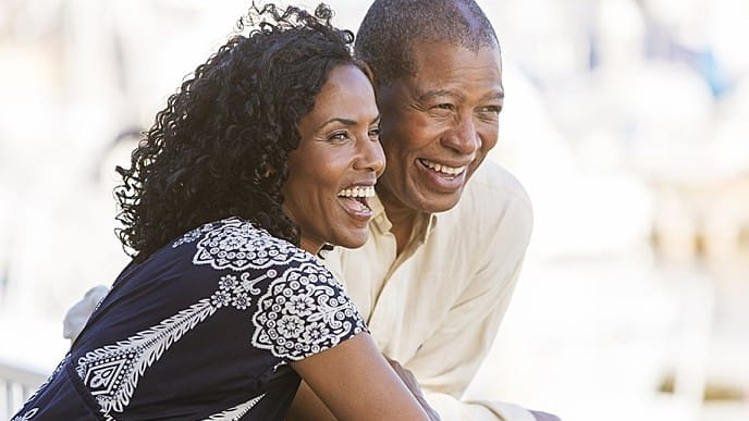 A smiling couple with dental crowns