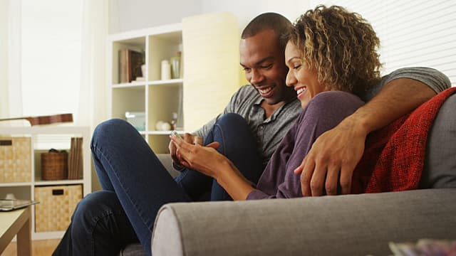 Couple Relaxes on Couch After Tooth Extraction