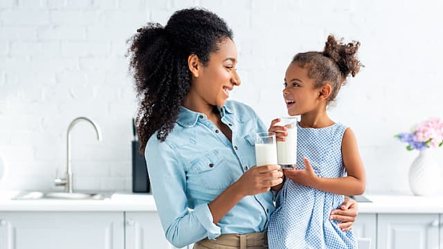 Mother and Daughter Drink Milk to Restore Saliva pH