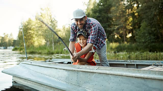 Father and Son Fish in a Lake