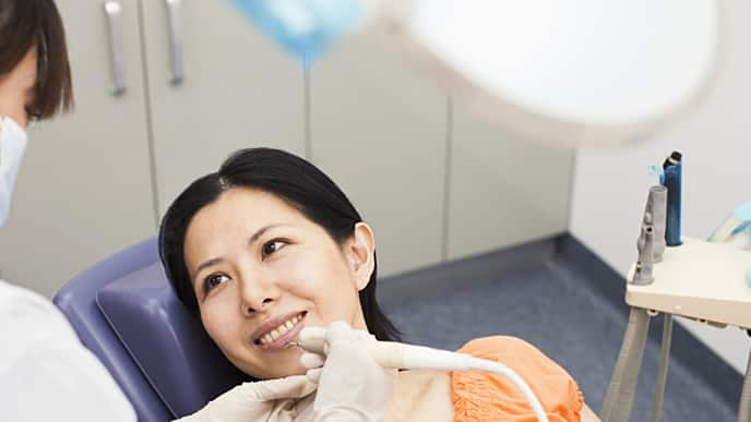 woman receiving novocaine from her dentist