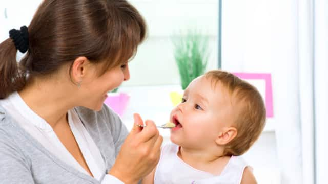 Toddler Eating Yogurt to Combat Bad Breath