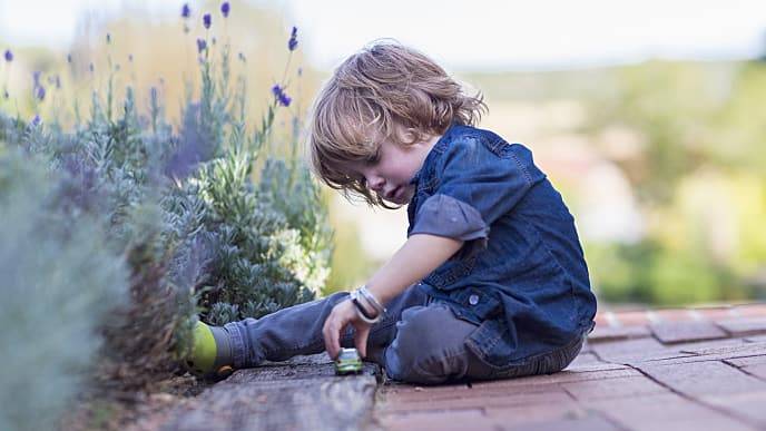 Kid playing with toy in the garden