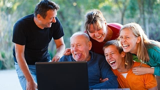 Funny grandpa making funny faces and families are laughing together