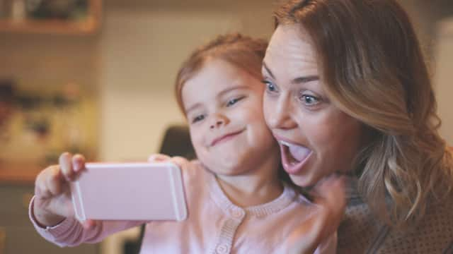 Mother with daughter making funny face