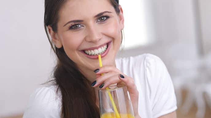 young woman drinking juice