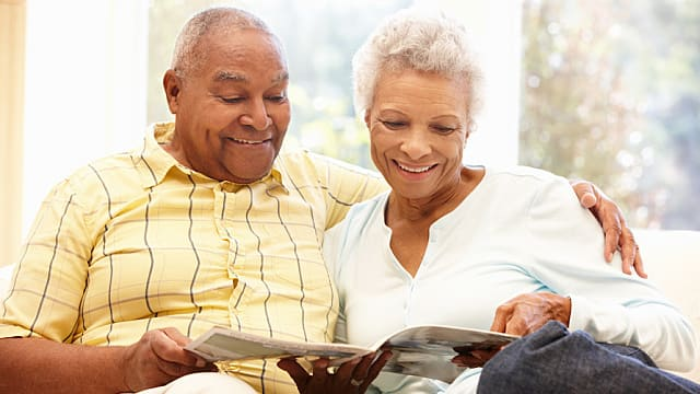 Senior African American couple reading