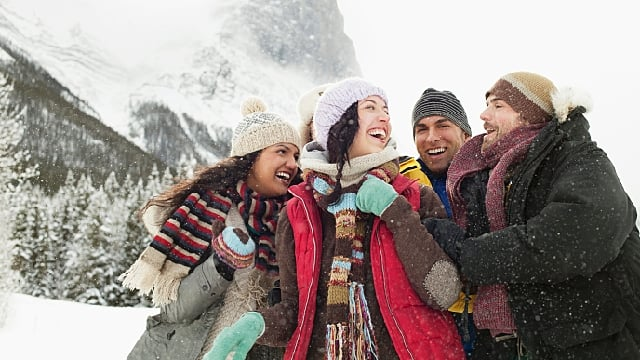 Group of friends laughing and enjoying outdoors in winter