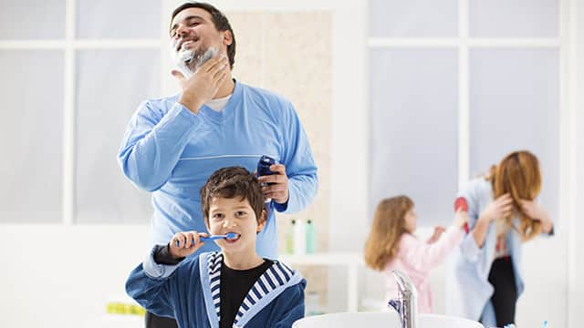 Parents brush teeth with kids together