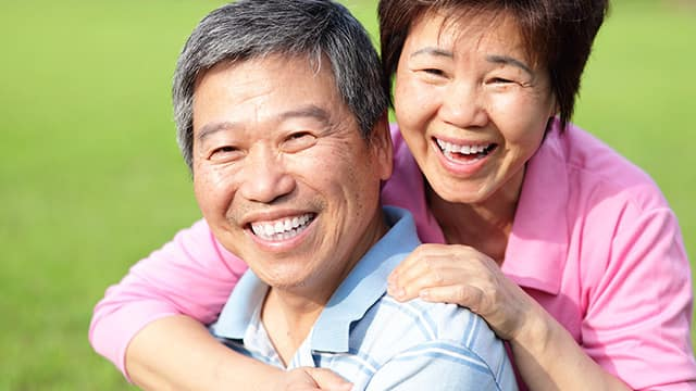 elderly Asian couple smiling