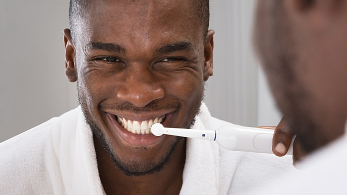 man brushing gums no longer bleeding