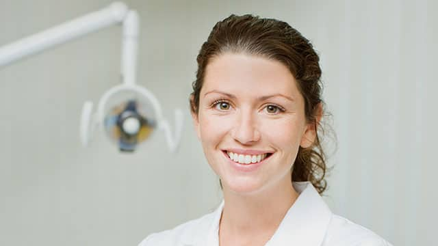 A female dental hygienist in the dental office