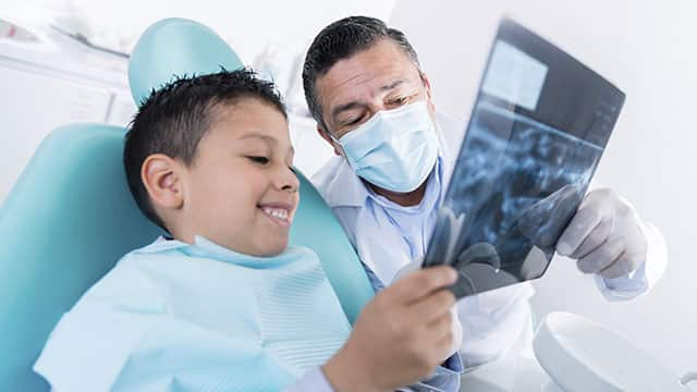 Dentist and kid in the dental office
