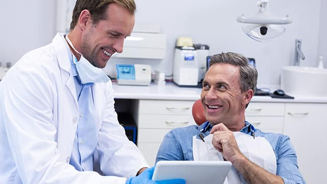 Dentist talking to patient about needs