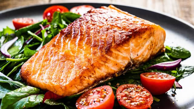 Grilled salmon on a plate with veggies
