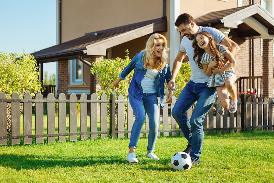 family playing soccer together