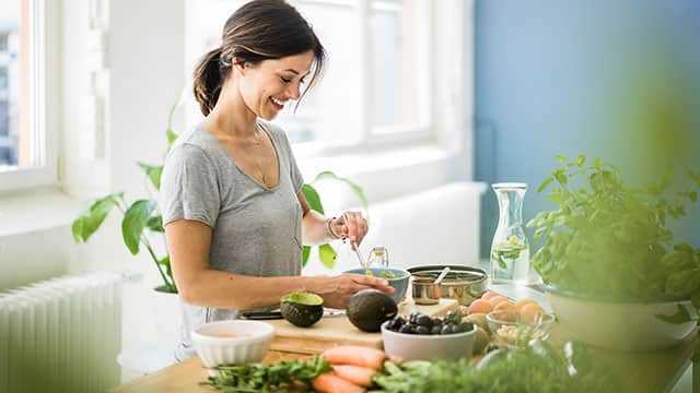 A woman is preparing a healthy food