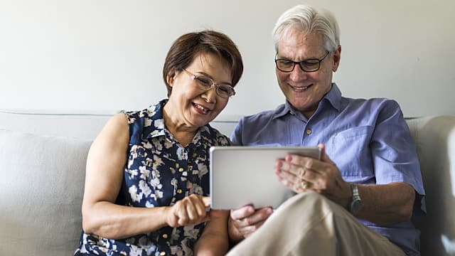 An Older Couple Browses the Internet