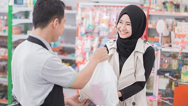Woman Buying Cetylpyridinium Chloride Mouthrinse