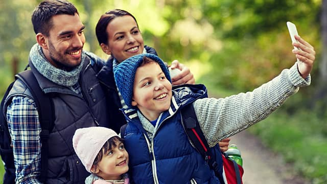 Family With Two Children Taking Selfie in the Woods