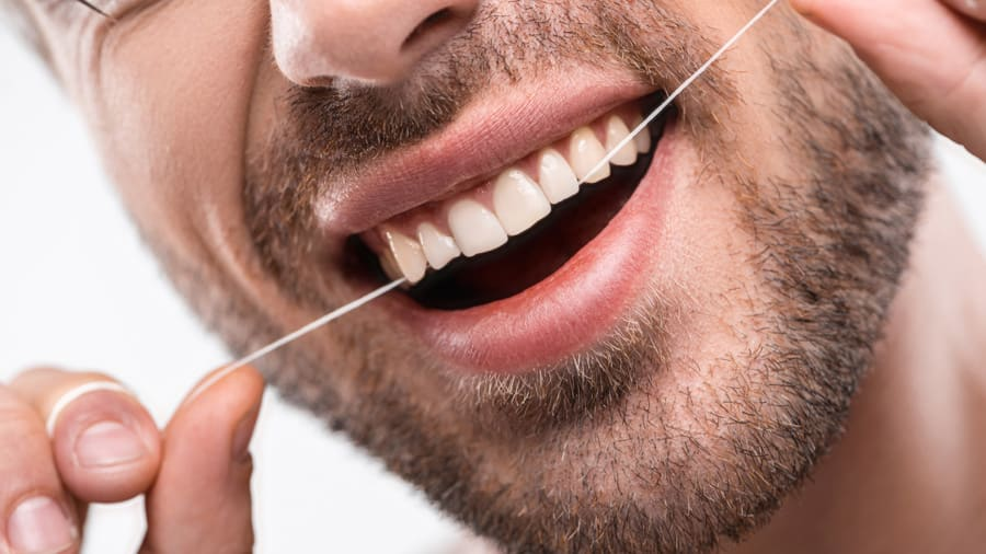how to floss properly - colgate in
