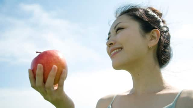 young lady eating apple