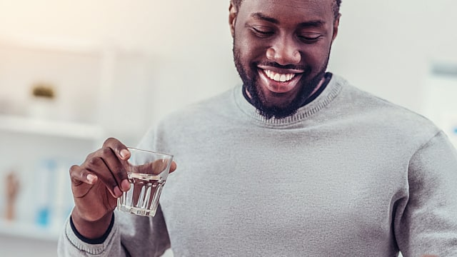 Positive minded African American man taking medication